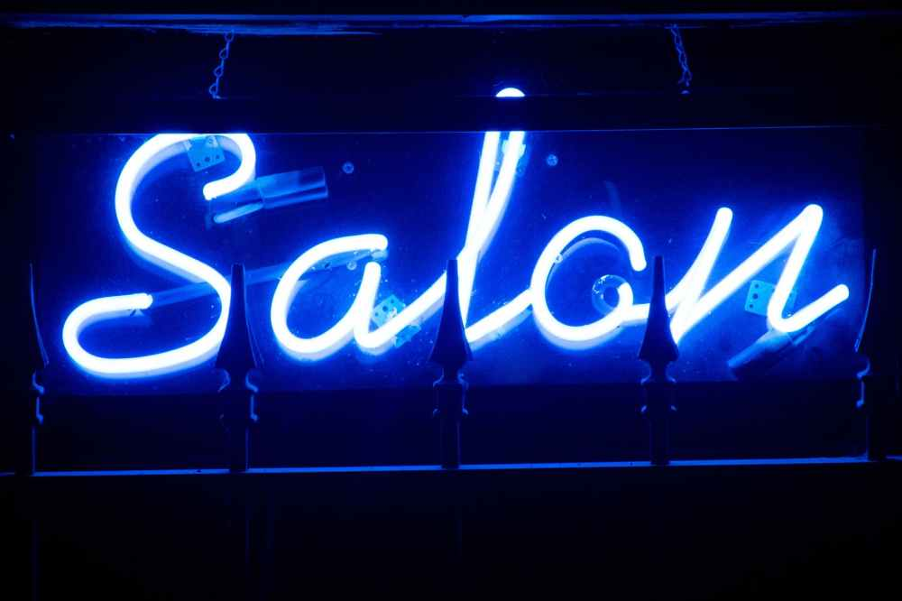 blue salon neon signage